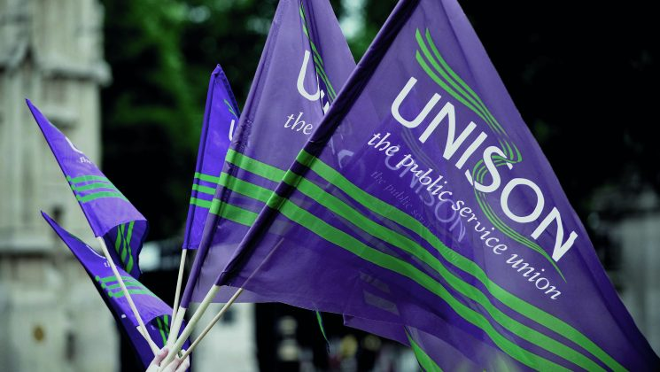 5 Purple UNISON flags held in hand